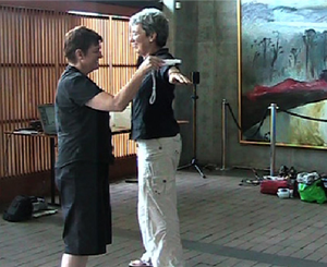 Two people interacting in a workshop